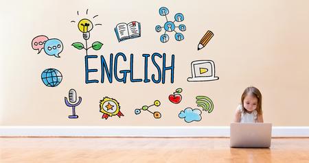 바닥에 랩톱 컴퓨터를 사용하는 어린 소녀와 영어 텍스트 스톡 콘텐츠