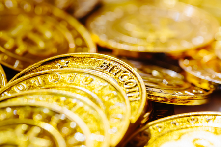 Pile of gold bitcoins in cyrptocurrency theme Stock Photo