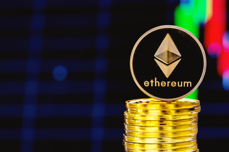 Stack of ether coins with a price chart in the background Stock Photo
