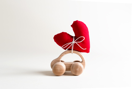 Valentines day theme with heart shaped cushions on toy car
