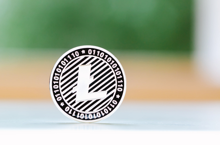 Litecoin crypotocurrency coin with bright blurred background