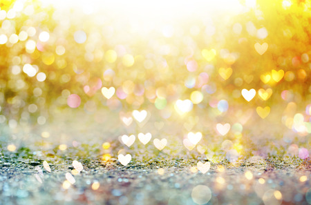 Beautiful shiny hearts and abstract lights background 写真素材