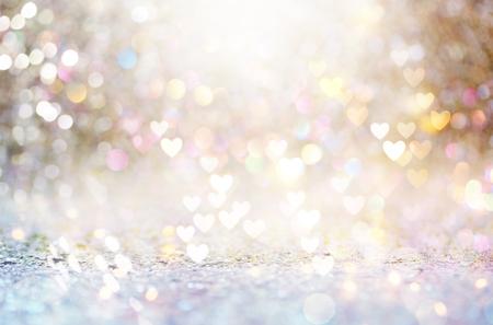 美しい光沢のある心と抽象的な光の背景 写真素材