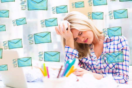 Emails with young woman with crumpled paper balls