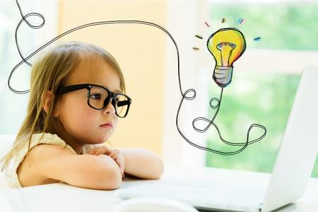 Light Bulb with little girl using her laptop