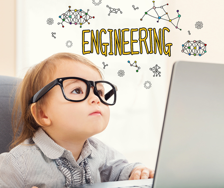 Engineering text with toddler girl using her laptop Stock Photo