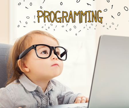 Programming text with toddler girl using her laptop Stock Photo - 92741591