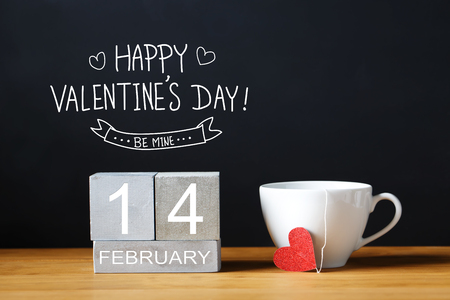 Valentines Day message with coffee cup with wooden blocks