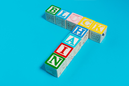 Blockchain concept with toy blocks on a blue background