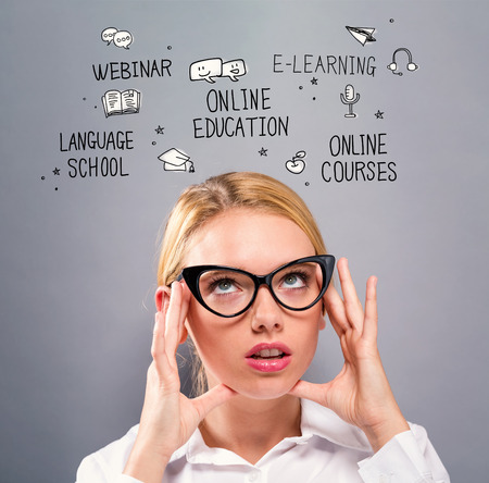 Online Education with business woman on a gray background
