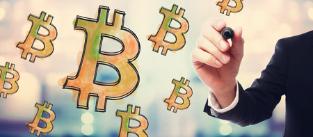 Bitcoinb with businessman on blurred abstract background