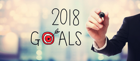 2018 Goals with businessman on blurred abstract background Stock Photo