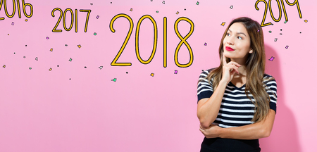 2018 with young woman in a thoughtful pose Imagens