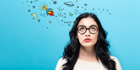 Idea Rocket with young woman on a blue background