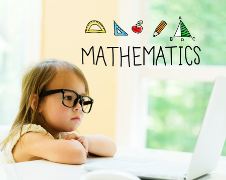 Mathematics text with little girl using her laptop Stock Photo