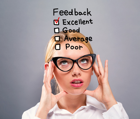 Feedback with business woman on a gray background