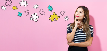 Puzzles with young woman in a thoughtful pose