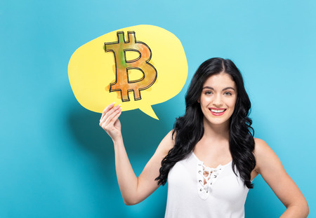 Bitcoin with young woman holding a speech bubble