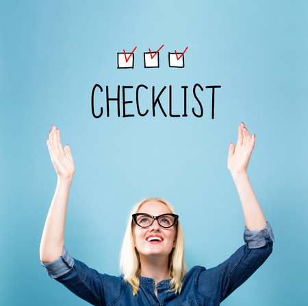 Checklist with young woman reaching and looking upwards