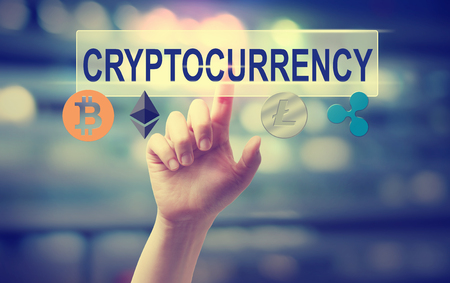 Cryptocurrency with hand pressing a button on blurred abstract background Zdjęcie Seryjne