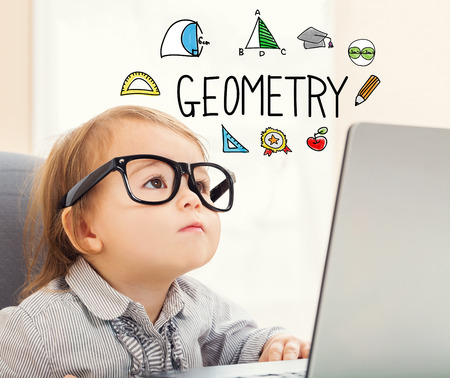 Geometry text with toddler girl using her laptop Stock Photo