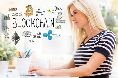 Blockchain with happy young woman sitting at her desk in front of the computer