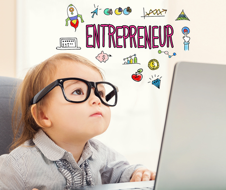Entrepreneur text with toddler girl using her laptop