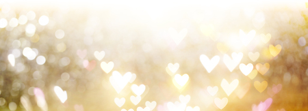 Beautiful shiny hearts and abstract lights background Imagens