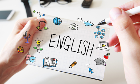 English with mans hands and a white notebook