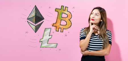 Bitcoin, Ethereum and Litecoin with young woman in a thoughtful pose Stock Photo