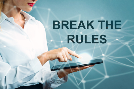 Break The Rules text with business woman using a tablet Stock fotó