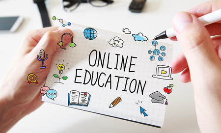 Online Education with mans hands and a white notebook Stock Photo - 94507948