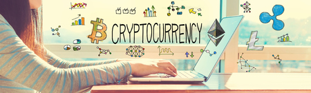 Cryptocurrency with woman working on a laptop in brightly lit room Zdjęcie Seryjne