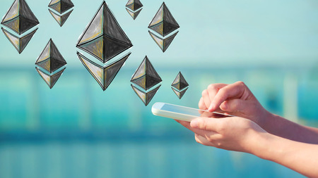 Ethereum illustration with person holding a smartphone