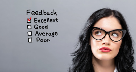 Feedback with young businesswoman in a thoughtful face Stock Photo