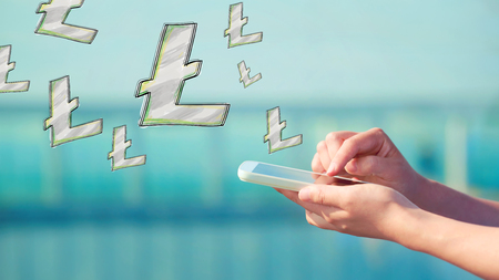 Litecoin illustration with person holding a smartphone