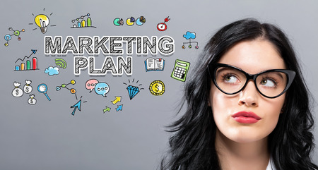 Marketing Plan with young businesswoman in a thoughtful face