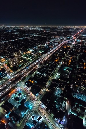 Aerial view of a massive highway in Los Angeles, CA at night 스톡 콘텐츠