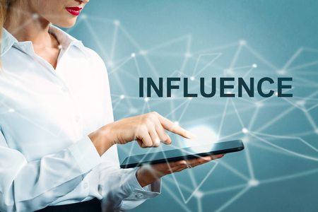 Influence text with business woman using a tablet