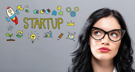 Startup with young businesswoman in a thoughtful face