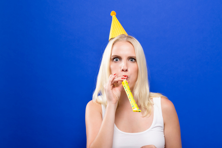 Young woman with party theme on a solid background Stock Photo