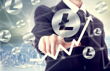Litecoin concept with businessman above the city