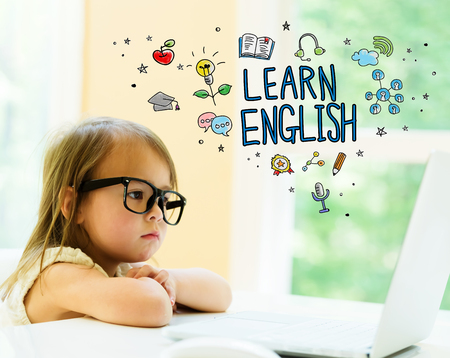 Learn English text with little girl using her laptop