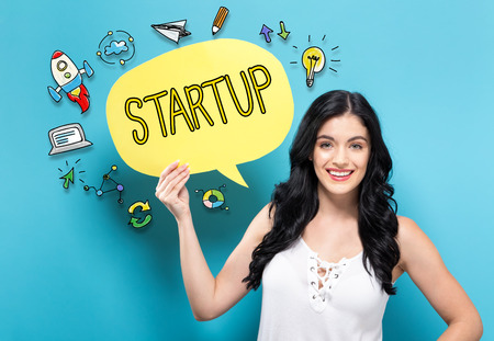 Startup with young woman holding a speech bubble Stock Photo