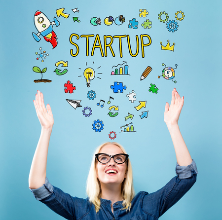 Startup with young woman reaching and looking upwards Standard-Bild