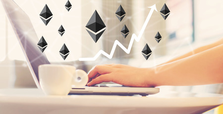 Ethereum with woman using a laptop in brightly lit room