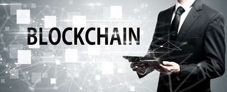 Blockchain with man holding a tablet computer