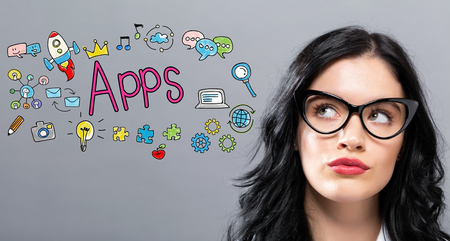Apps with young businesswoman in a thoughtful face Standard-Bild