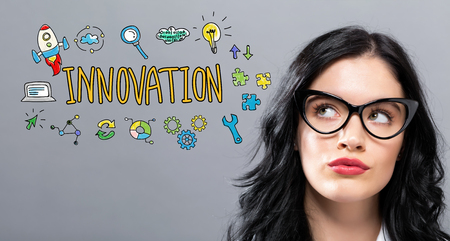 Innovation with young businesswoman in a thoughtful face