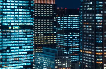 Skyscrapers illuminated at night in Tokyo, Japan Stock Photo